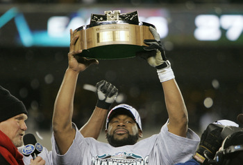 PHILADELPHIA - JANUARY 23:  Quarterback Donovan McNabb #5 of the Philadelphia Eagles celebrates with the George Halas NFC Championship trophy after defeating the Atlanta Falcons 27-10 in the NFC Championship game at Lincoln Financial Field on January 23, 
