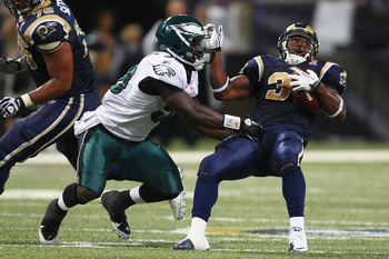 ST. LOUIS - SEPTEMBER 11: Trent Cole #58 of the Philadelphia Eagles tackles Cadillac Williams #33 of the St. Louis Rams at the Edward Jones Dome on September 11, 2011 in St. Louis, Missouri. The Eagles beat the Rams 31-13. (Photo by Dilip Vishwanat/Getty