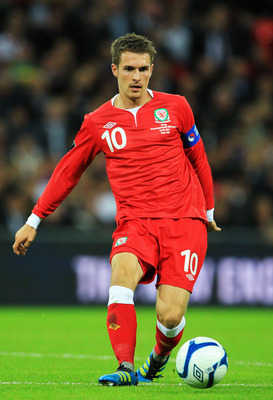 LONDON, ENGLAND - SEPTEMBER 06:  Aaron Ramsey of Wales runs with the ball during the UEFA EURO 2012 group G qualifying match between England and Wales at Wembley Stadium  on September 6, 2011 in London, England.  (Photo by David Cannon/Getty Images)