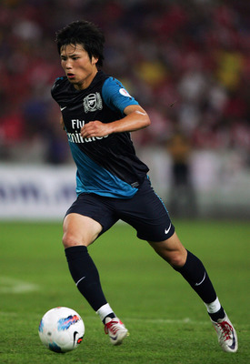 KUALA LUMPUR, MALAYSIA - JULY 13: Ryo Miyaichi of Arseal dribbles during the pre-season Asian Tour friendly match between Malaysia and Arsenal at Bukit Jalil National Stadium on July 13, 2011 in Kuala Lumpur, Malaysia.  (Photo by Stanley Chou/Getty Images