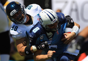 JACKSONVILLE, FL - SEPTEMBER 11:  Matt Hasselbeck #8 of the Tennessee Titans is sacked by Matt Roth #90 of the Jacksonville Jaguars during their season opener at EverBank Field on September 11, 2011 in Jacksonville, Florida.  (Photo by Streeter Lecka/Gett