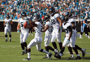 JACKSONVILLE, FL - SEPTEMBER 11:  Dwight Lowery #25 of the Jacksonville Jaguars celebrates after an interception to seal the game with a 16-14 victory over the Tennessee Titans during their season opener at EverBank Field on September 11, 2011 in Jacksonv