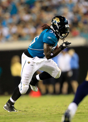 JACKSONVILLE, FL - SEPTEMBER 01:  Deji Karim #35 of the Jacksonville Jaguars runs for yardage during a game against the St. Louis Rams at EverBank Field on September 1, 2011 in Jacksonville, Florida.  (Photo by Sam Greenwood/Getty Images)