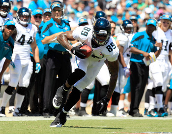 JACKSONVILLE, FL - SEPTEMBER 11:  Marcedes Lewis #89 of the Jacksonville Jaguars runs following a reception during the season opener game against the Tennessee Titans at EverBank Field on September 11, 2011 in Jacksonville, Florida.  (Photo by Sam Greenwo