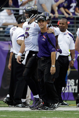 BALTIMORE, MD - SEPTEMBER 11: Quarterback  Joe Flacco #5 of the Baltimore Ravens is congratulated by head coach John Harbaught after Flacco threw a touchdown pass against the Pittsburgh Steelers during second half of the season opener at M&T Bank Stadium