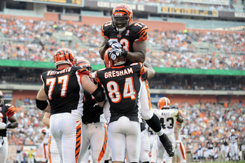 CLEVELAND, OH - SEPTEMBER 11:  Anthony Collins #73 celebrates with Jermaine Gresham #84 of the Cincinnati Bengals after Gresham scored a touchdown during the first quarter against the Cleveland Browns Cleveland Browns Stadium season opener on September 11