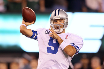 EAST RUTHERFORD, NJ - SEPTEMBER 11:  Tony Romo #9 of the Dallas Cowboys throws a pass against the New York Jets during their NFL Season Opening Game at MetLife Stadium on September 11, 2011 in East Rutherford, New Jersey.  (Photo by Elsa/Getty Images)