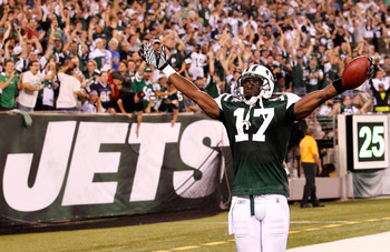 EAST RUTHERFORD, NJ - SEPTEMBER 11:  Plaxico Burress #17 of the New York Jets celebrates after he scored a 26-yard touchdown in the fourth quarter against the Dallas Cowboys during their NFL Season Opening Game at MetLife Stadium on September 11, 2011 in
