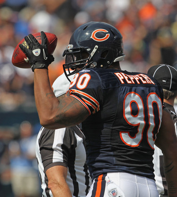 CHICAGO, IL - SEPTEMBER 11:  Julius Peppers #90 of the Chicago Bears holds up the ball after recovering a fumble against the Atlanta Falcons at Soldier Field on September 11, 2011 in Chicago, Illinois. The Bears defeated the Falcons 30-12.  (Photo by Jona