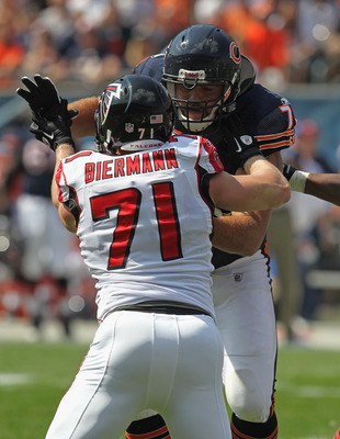 CHICAGO, IL - SEPTEMBER 11: Gabe Carimi #72 of the Chicago Bears blocks Kroy Biermann #71 of the Atlanta Falcons at Soldier Field on September 11, 2011 in Chicago, Illinois. The Bears defeated the Falcons 30-12. (Photo by Jonathan Daniel/Getty Images)