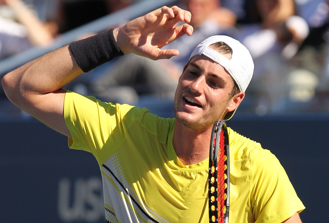NEW YORK, NY - SEPTEMBER 09:  John Isner of the United States celebrates after a point against Andy Murray of Great Britain during Day Twelve of the 2011 US Open at the USTA Billie Jean King National Tennis Center on September 9, 2011 in the Flushing neig