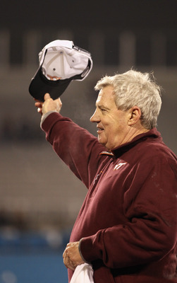 CHARLOTTE, NC - DECEMBER 04:  Head coach Frank Beamer of the Virginia Tech Hokies waves to fans as he celebrates winning the ACC Championship 44-33 at Bank of America Stadium on December 4, 2010 in Charlotte, North Carolina.  (Photo by Streeter Lecka/Gett