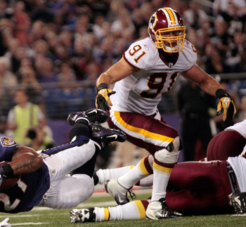 BALTIMORE, MD - AUGUST 25:  Running back Ray Rice #27 of the Baltimore Ravens leaps into the end zone for a touchdown in front of Ryan Kerrigan #91 of the Washington Redskins during the first half of a preseason game at M&T Bank Stadium on August 25, 2011