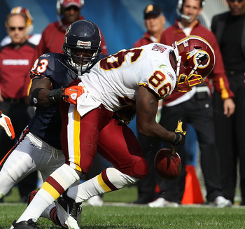 CHICAGO - OCTOBER 24: Fred Davis #86 of the Washington Redskins fumbles the ball as he is hit by Charles Tillman #33 of the Chicago Bears as Pisa Tinoisamoa #59 closes in at Soldier Field on October 24, 2010 in Chicago, Illinois. The Redskins defeated the