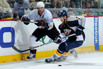 NASHVILLE, TN - APRIL 20:  Teemu Selanne #8 of the Anaheim Ducks skates against Jonathon Blum #7 of the Nashville Predators in Game Four of the Western Conference Quarterfinals during the 2011 NHL Stanley Cup Playoffs at Bridgestone Arena on April 20, 201