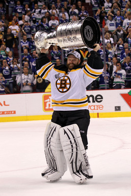 VANCOUVER, BC - JUNE 15:  Tim Thomas #30 of the Boston Bruins celebrates with the Stanley Cup after defeating the Vancouver Canucks in Game Seven of the 2011 NHL Stanley Cup Final at Rogers Arena on June 15, 2011 in Vancouver, British Columbia, Canada. Th