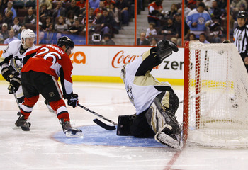 OTTAWA, CANADA - MARCH 15:  Ryan Shannon #26 of the Ottawa Senators fires a backhand shot into the net for a goal against Brent Johnson #1 of the Pittsburgh Penguins during a game at Scotiabank Place on March 15, 2011 in Ottawa, Canada.  (Photo by Phillip