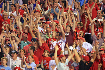 PHILADELPHIA - JUNE 10: Philadelphia Phillies fans cheer for Placido Polanco's grand slam home run during a game against the Chicago Cubs at Citizens Bank Park on June 10, 2011 in Philadelphia, Pennsylvania. The Phillies won 7-5. (Photo by Hunter Martin/G