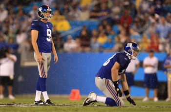 CHARLOTTE, NC - AUGUST 13:  Lawrence Tynes #9 of the New York Giants against the Carolina Panthers during their preseason game at Bank of America Stadium on August 13, 2011 in Charlotte, North Carolina.  (Photo by Streeter Lecka/Getty Images)