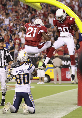 GLENDALE, AZ - AUGUST 27:  Cornerbacks Patrick Peterson #21 and A.J. Jefferson #20 of the Arizona Cardinals celebrate after wide receiver Malcom Floyd #80 of the San Diego Chargers droped a pass in the end zone during the preseason NFL game at the Univers