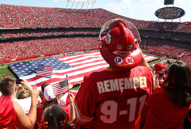 KANSAS CITY, MO - SEPTEMBER 11:  A giant flag is unrolled during the National Anthem to commemorate the 10th anniversary of September 11th prior to the start of the game between the Buffalo Bills and the Kansas City Chiefs at Arrowhead Stadium on Septembe