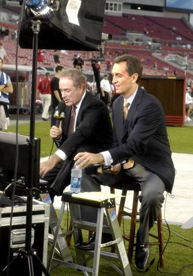 TAMPA, FL - OCTOBER 19:  Al Michaels and Cris Collinsworth offer pre-game commentary from the sideline as the Tampa Bay Buccaneers host the Seattle Seahawks at Raymond James Stadium on October 19, 2008 in Tampa, Florida.  (Photo by Al Messerschmidt/Getty