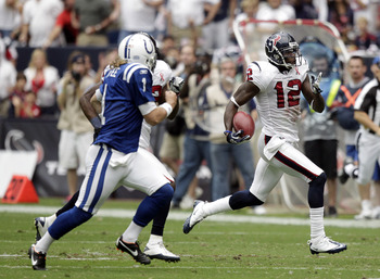 HOUSTON - SEPTEMBER 11:  Jacoby Jones #12 of the Houston Texans runs a punt back for 80 yards for a touchdown as punter Pat McAfee #1 can't make the tackle in the second quarter against the Indianapolis Colts during the season opener at Reliant Stadium on
