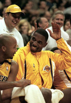 26 Nov 1999: A.C. Green #45 of the Los Angels Lakers smiles with bunny ears from the bench during the game against the New Jersey Nets at the Staples Center in Los Angeles, California. The Lakers defeated the Nets 103-80.