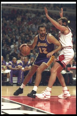 11 Mar 1995:  Center Vlade Divac of the Los Angeles Lakers moves the ball during a game against the Chicago Bulls at the United Center in Chicago, Illinois. Mandatory Credit: Jonathan Daniel  /Allsport Mandatory Credit: Jonathan Daniel  /Allsport