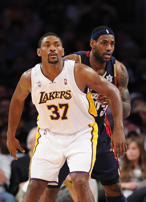 LOS ANGELES, CA - DECEMBER 25: Ron Artest #37 of the Los Angeles Lakers and LeBron James #23 of the Cleveland Cavaliers battle for position during the game at Staples Center on December 25, 2009 in Los Angeles, California. NOTE TO USER: User expressly ack