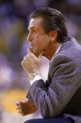 LOS ANGELES - 1987:  Head coach Pat Riley of the Los Angeles Lakers crouches on the sideline during an NBA game at the Great Western Forum in Los Angeles, California in 1987. (Photo by: Stephen Dunn/Getty Images)