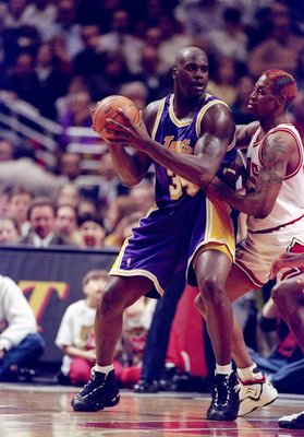 17 Dec 1996:  Forward Dennis Rodman of the Chicago Bulls (right) covers Los Angeles Lakers center Shaquille O''Neal during a game at the United Center in Chicago, Illinois.  The Bulls won the game, 129-123. Mandatory Credit: Jonathan Daniel  /Allsport