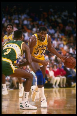 Guard Earvin (Magic) Johnson of the Los Angeles Lakers moves the ball during a game against the Seattle SuperSonics at the Key Arena in Seattle, Washington.