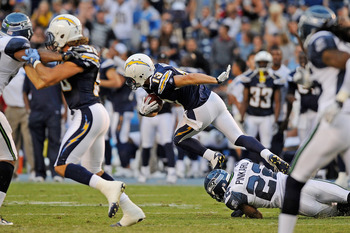 SAN DIEGO, CA - AUGUST 11:  Bryan Walters #13 of the San Diego Chargers eludes a tackle by Josh Pinkard #22 of the Seattle Seahwaks as he returns a kick for 103 yard touchdown during the NFL preseason game at Qualcomm Stadium on August 11, 2011 in San Die