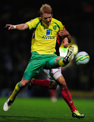 NORWICH, ENGLAND - APRIL 15:  Zak Whitbread of Norwich City battles with Nathan Tyson of Nottingham Forest during the npower Championship match between Norwich City and Nottingham Forest at Carrow Road on April 15, 2011 in Norwich, England.  (Photo by Jam