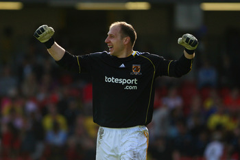WATFORD, ENGLAND - APRIL 09:  Brad Guzan of Hull celebrates his team's second goal during the npower Championship match between Watford and Hull at Vicarage Road on April 9, 2011 in Watford, England.  (Photo by Dan Istitene/Getty Images)