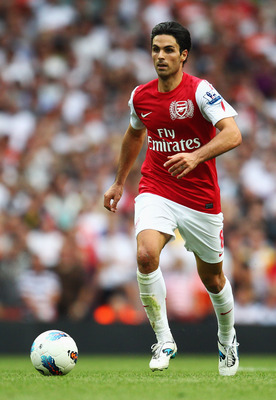 LONDON, ENGLAND - SEPTEMBER 10:  Mikel Arteta of Arsenal in action during the Barclays Premier League match between Arsenal and Swansea City at Emirates Stadium on September 10, 2011 in London, England.  (Photo by Clive Mason/Getty Images)