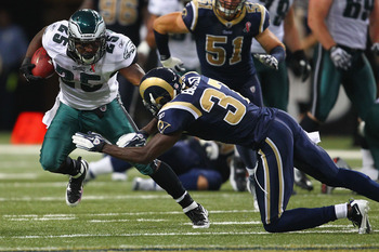 ST. LOUIS - SEPTEMBER 11: LeSean McCoy #25 of the Philadelphia Eagles looks to escape a tackle by James Butler #37 of the St. Louis Rams at the Edward Jones Dome on September 11, 2011 in St. Louis, Missouri. The Eagles beat the Rams 31-13. (Photo by Dilip