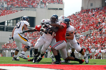 COLUMBUS, OH - SEPTEMBER 10:  Adonis Thomas #24 of the Toledo Rockets powers through the Ohio State Buckeyes defense to score during the third quarter on September 10, 2011 at Ohio Stadium in Columbus, Ohio. Ohio State defeated Toledo 27-22. (Photo by Kir
