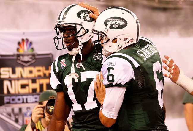 EAST RUTHERFORD, NJ - SEPTEMBER 11:  (L-R) Plaxico Burress #17 and Mark Sanchez #6 of the New York Jets celebrate after Burress scored a 26-yard touchdown reception in the fourth quarter against the Dallas Cowboys during their NFL Season Opening Game at M