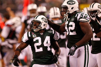 EAST RUTHERFORD, NJ - SEPTEMBER 11:  Darrelle Revis #24 and David Harris #52 of the New York Jets celebrate after Revis intercepted a pass in the fourth quarter against the Dallas Cowboys during their NFL Season Opening Game at MetLife Stadium on Septembe