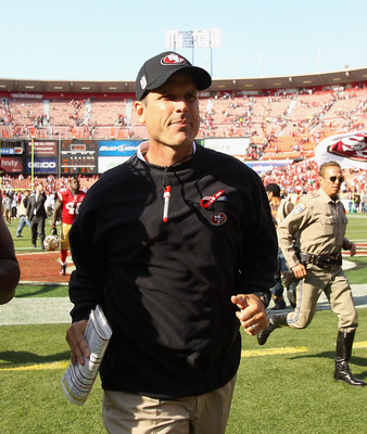 SAN FRANCISCO, CA - SEPTEMBER 11:  San Francisco 49ers head coach Jim Harbaugh runs off the field after they beat the Seattle Seahawks in their season opener at Candlestick Park on September 11, 2011 in San Francisco, California.  (Photo by Ezra Shaw/Gett