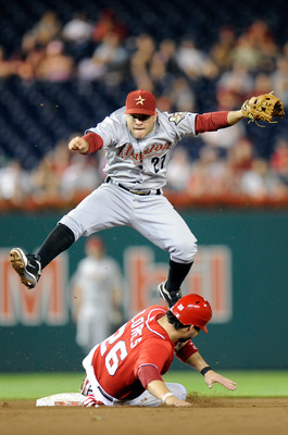 WASHINGTON, DC - SEPTEMBER 10:  Jose Altuve #27 of the Houston Astros jumps over Jesus Flores #26 of the Washington Nationals after forcing him out at second base in the ninth inning at Nationals Park on September 10, 2011 in Washington, DC.  (Photo by Gr