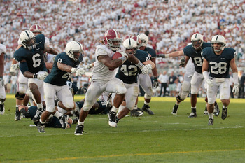 Running back Trent Richardson, of No. 3 Alabama, running away from the Penn State defense