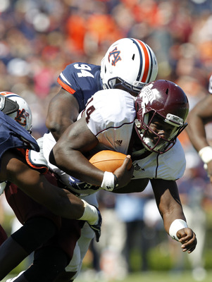 Mississippi State QB Chris Relf, being brought down by Auburn DT Nosa Eguae