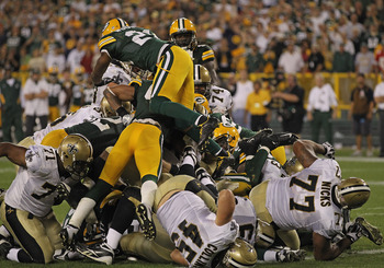 GREEN BAY, WI - SEPTEMBER 08: Members of the Green Bay Packer defense stop the New Orleans Saints short of the goal on the final play of the game during the NFL opening season game at Lambeau Field on September 8, 2011 in Green Bay, Wisconsin. The Packers