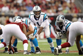 GLENDALE, AZ - SEPTEMBER 11:  Quarterback Cam Newton #1 of the Carolina Panthers snaps the football during the NFL season opening game against the Arizona Cardinals at the University of Phoenix Stadium on September 11, 2011 in Glendale, Arizona. The Carin