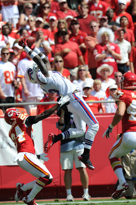 KANSAS CITY, MO - SEPTEMBER 11:  Wide receiver Stevie Johnson #13 of the Buffalo Bills catches a 27-yard touchdown pass over defensive back Brandon Flowers #24 of the Kansas City Chiefs during the first quarter on September 11, 2011 at Arrowhead Stadium i