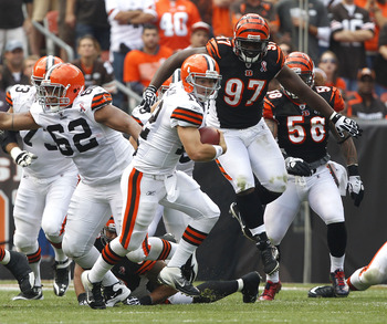 CLEVELAND, OH - SEPTEMBER 11:  Quarterback Colt McCoy #82 of the Cleveland Browns runs from Geno Atkins #97 of the Cincinnati Bengals during the season opener at Cleveland Browns Stadium on September 11, 2011 in Cleveland, Ohio.  (Photo by Matt Sullivan/G
