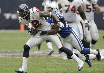 HOUSTON, TX - SEPTEMBER 11:  Wide receiver Jacoby Jones #12 of the Houston Texans is tackled by defensive back Jerraud Powers #25 of the Indianapolis Colts on September 11, 2011 at Reliant Stadium in Houston, Texas. Texans won 34 to 7.(Photo by Thomas B.
